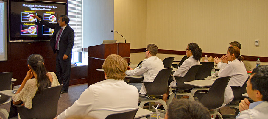 medical residents in classroom during lecture