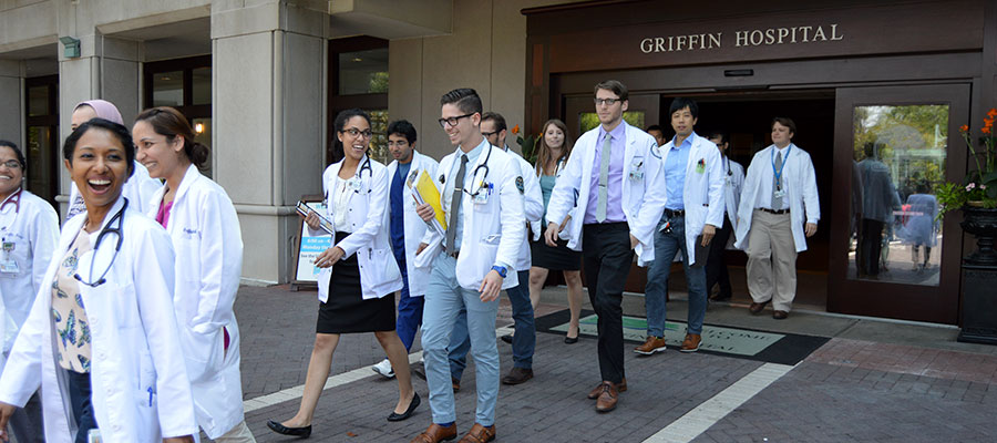 group of medical residents exiting Griffin Hospital front entrance